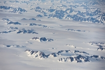 Really glad I chose a window seat Flying high over Greenland