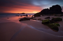 Receding tide I used a long shutter speed to capture movement and glow from fading sunset Portugal