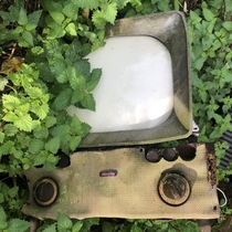 Recently explored an abandoned cottage amp farm Had to go through a lot of junk but there were a few gems left behind this vintage Murphy TV being one of them Link in comments for more