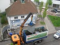 Recycling pick up in Switzerland Underground bins sit on scales and are emptied once they reach a certain weight The crane is operated by remote control by the driver and the bottom of each bin opens to empty into the truck Noisy but efficient