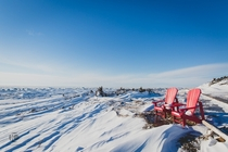 Red Chairs at Bakers Brook Gros Morne National Park Canada Ice as far as the eye can see