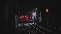 red lights on subway tunnel tracks