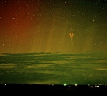 Red Sprite Lightning with Aurora in South Dakota -- A red sprite is a rarely seen form of lightning confirmed only about  years ago