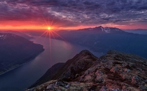 Red Star - sunset over the fjords of Sunndal Norway  by Haakon Nygaard