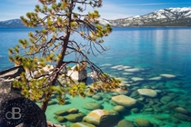 Reddit liked my last photo here so here is another Crystal clear waters and granite boulders of Sand Harbor Lake Tahoe CaliforniaNevada border