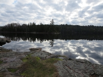 Reflection of the clouds on calm clear water Western Boundary Waters Minnesota