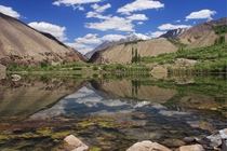 Reflection of the mountains photographer Ghulam Rasool
