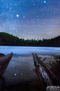 Reflection of the stars in the mostly frozen Upper Twin Lakes Oregon