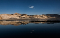 Reflection of the white sand hills over Sand Lake on the Pamir Plateau China