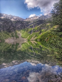 Reflections of Rainy Lake in the North Cascades of Washington