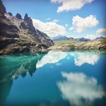 Reflections over the Schottensee an alpine lake in the Swiss Alps