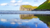 Reflective beach at Tjornuvik Faroe Islands  OC