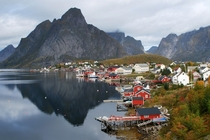 Reine - a small fishing village nestled between the sea and lofty mountains in the Lofoten Islands photographed by Jennifer Batryn