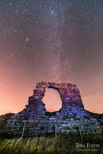 Remains of old Newark Castle St Monans Scotland and a number of galaxies