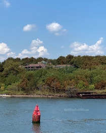 Remains of Riverside Hospital on North Brother Island - now uninhabited and a bird sanctuary - as seen from the East River Ferry The Bronx New York City