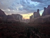 Reminds me of something from the Lion King Arches National Park with a moody storm passing through the sunset