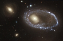 Resembling a diamond-encrusted bracelet a ring of brilliant blue star clusters wraps around the yellowish nucleus of Galaxy AM - what was once a normal spiral galaxy The sparkling blue ring is  light-years in diameter making it larger than the entire Milk