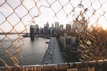 Reshot lower Manhattan through this hole in the fence yesterday caught a cool ray of light too