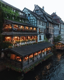 Restaurant on the River Ill flowing through the historic Petite France quarter of Strasbourg France