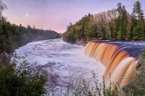 Rewarded with a beautiful sunrise and moonrise at Tahquamenon Falls in the UP of Michigan after driving  hours in the middle of the night from Detroit
