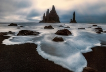 Reynisdrangar Basalt sea stacks situated near Vk in Southern Iceland