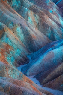 Rich mineral presence colors the hills at Zabriskie Point in Death Valley National Park an otherworldly rainbow