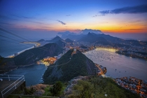 Rio de Janeiro at sunset from atop Sugarloaf Mountain  by Adhemar Duro