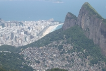 Rio de Janiero Rocinha favela in the foreground Ipanema in the background OC x