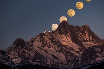 Rise of the super moon behind the Schreckhorn mft - the northernmost four-thousand-metre peak in Europe