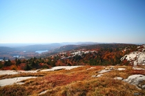 Rolling hills of granite rocks seen from the top of Silver Peak Killarney Provincial Park Canada
