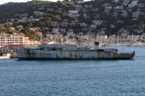 Rotting french hospital ship Rance in front of the Toulon yacht harbour