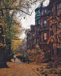Row of Victorian townhouses lining a street in Back Bay Boston Massachusetts