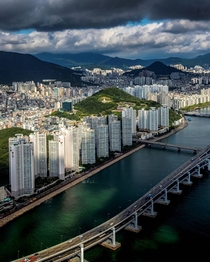 Rows of high-rise apartments facing the Suyeong Bay in mountainous Busan South Korea