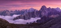 Rugged peaks during a fiery sunset in the Dolomites Italy