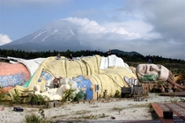 Ruins of Gullivers Kingdom Amusement Park in Japan with Mount Fuji in the distance