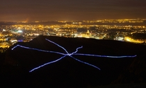 Runners taking part in NVAs Speed of Light create a visual display with their LED suits during a performance on Arthurs Seat in Edinburgh