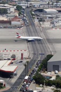 Runway at Gibraltar International Airport Intersecting main road must be closed whilst runway is in use