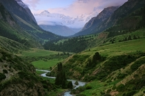 Rural Kyrgyzstan with Tian Shan in the background  by Ivan Dementievskiy