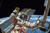 Russian cosmonaut Alexander Skvortsov gives a wave as he works outside the International Space Station on August th