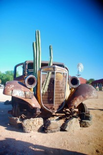 Rusted car w cactus near Fish River Canyon Namibia