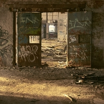 Rusted iron doors in an abandoned half demolished factory in Leipzig
