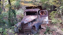 Rusted-out truck in the woods of Maine