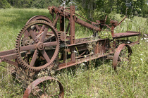 Rusting farm equipment in a field Western North Carolina