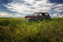 Rusting in the Badlands of South Dakota  by Ray Reiffenberger