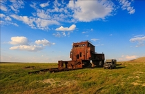 Rusting shipwreck on the dried up aral sea Photo by Denis Frantsouzov