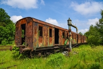 Rusty old carriage hidden in the Polish countryside