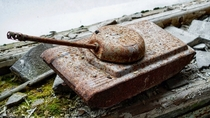 Rusty toy tank in the abandoned Childrens Hospital in Pripyat Chernobyl Exclusion Zone