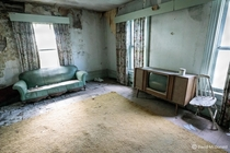 s style living room in an abandoned house in Quinte West complete with console tv