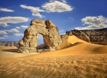 Sahara natural rock arch Libya  by Patrick Galibert