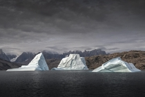 Sailing through the Bjorn OerBear Islands in Eastern Greenland we passed these three ancient pieces of ice on their long journey back into the sea